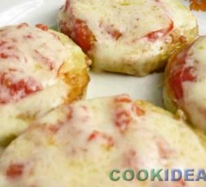Кабачки, запечёные с помидорами